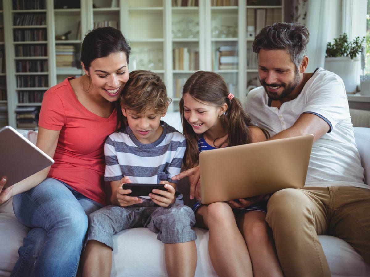 Happy family on webcam via laptop