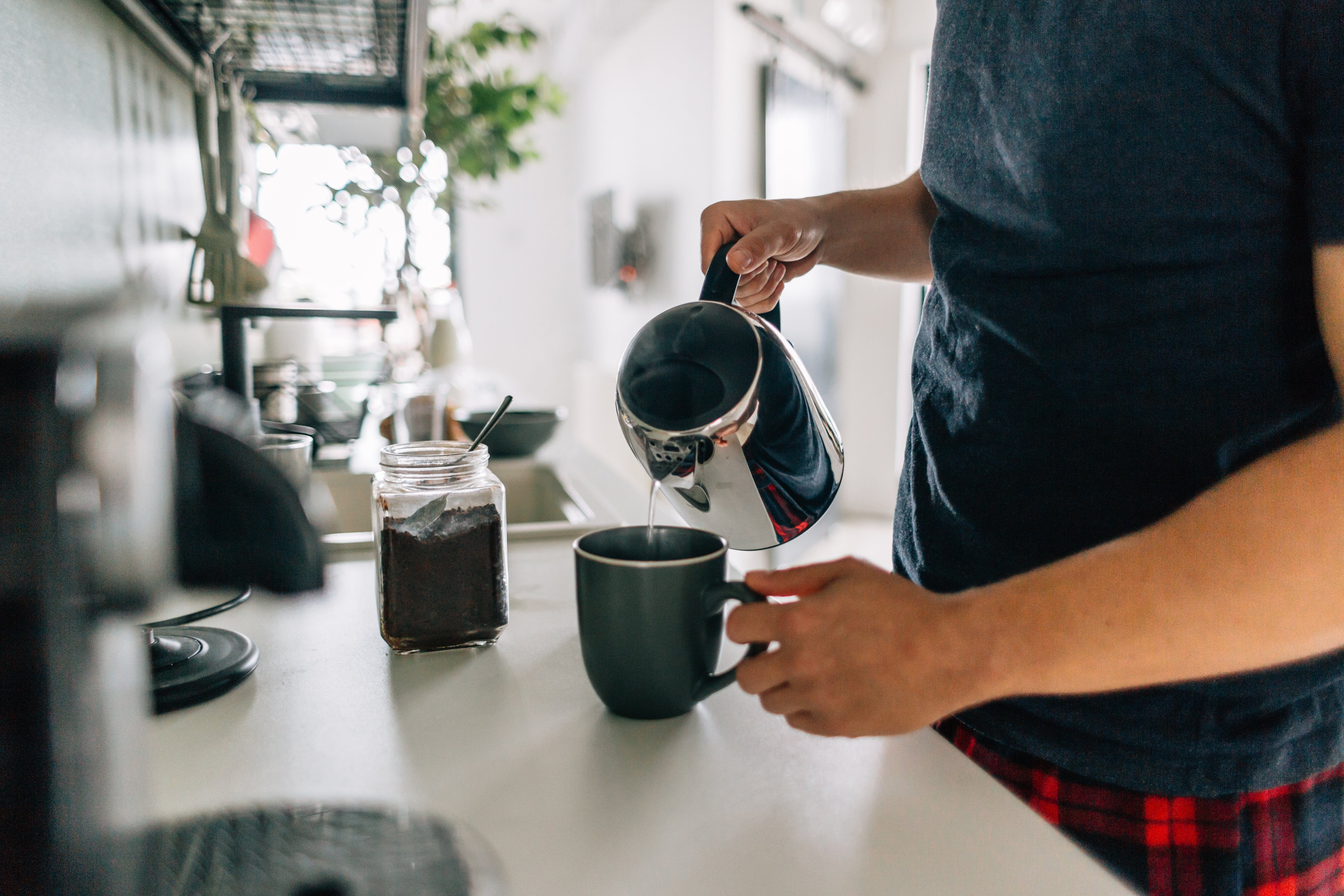 Preparing first cup of coffee in the morning