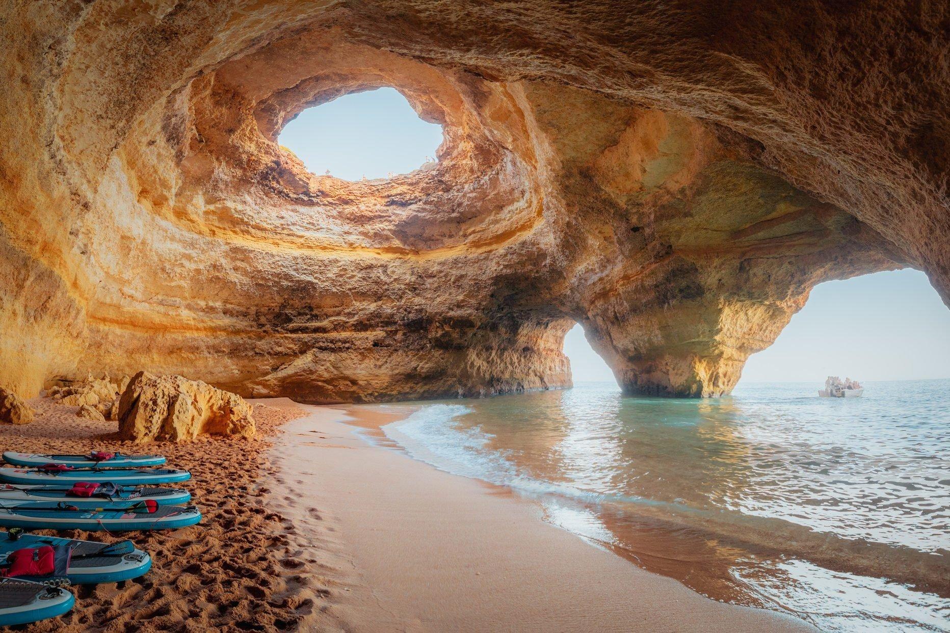Benagil Cave, Algarve, Portugal. SUP boards and beach