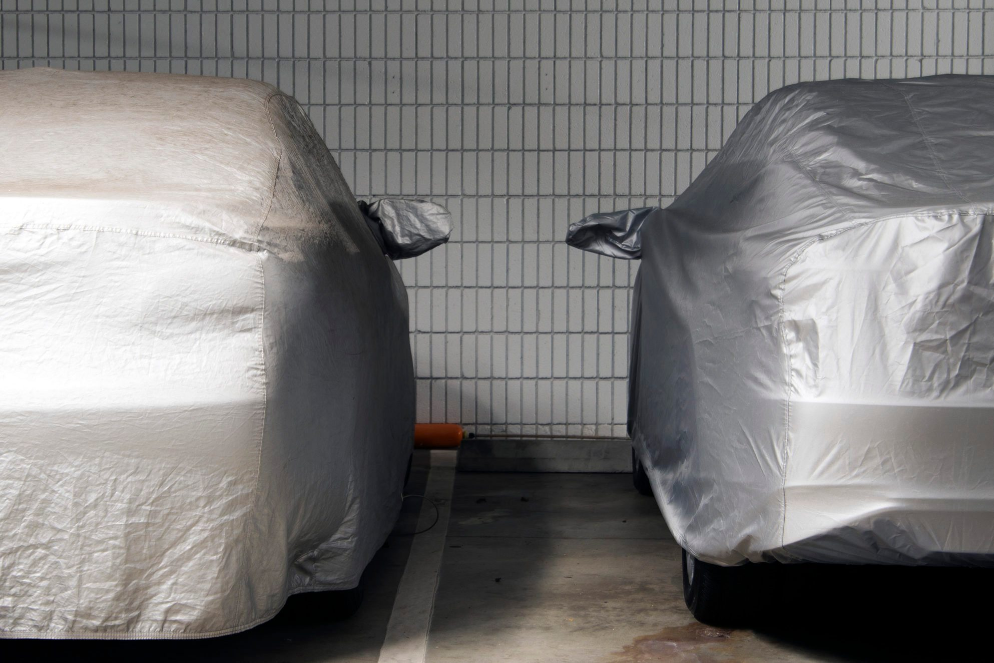 Close-Up Of Covered Car In Parking Garage
