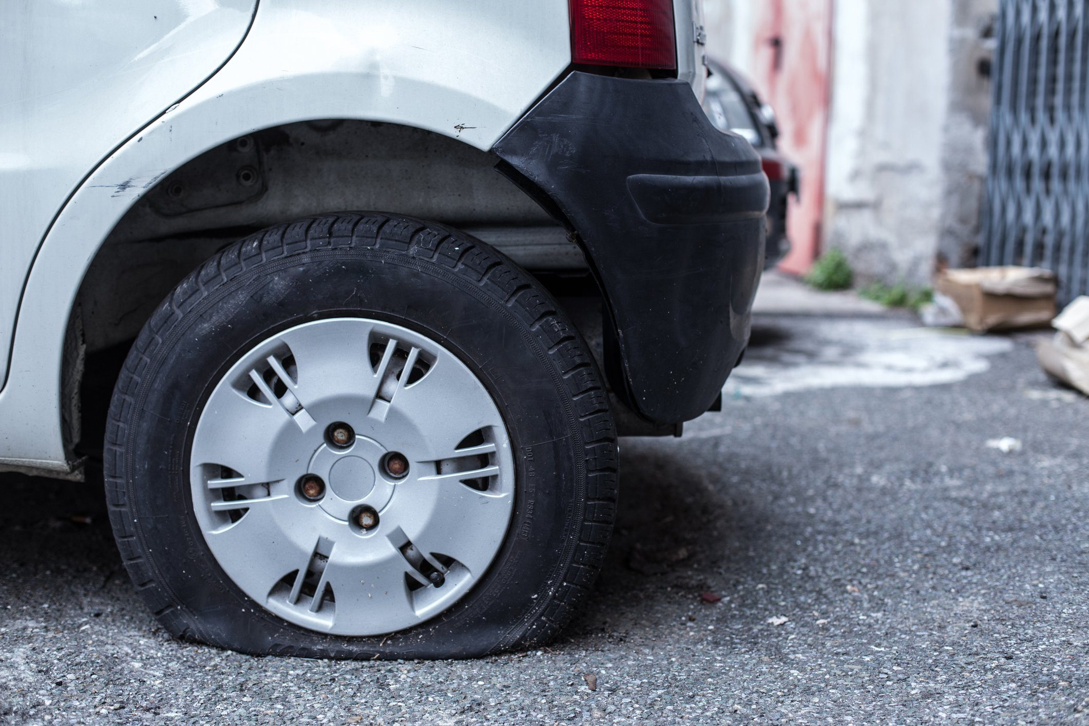 Close-Up Of Car With Puncture Tire