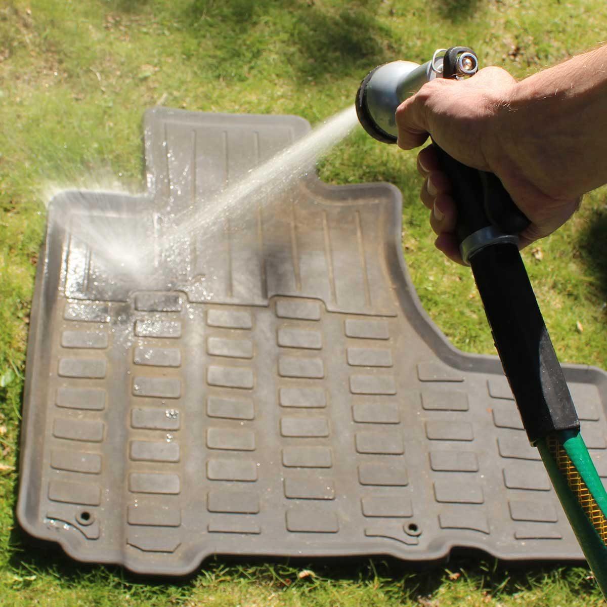 Step 1: spray the rubber car mats