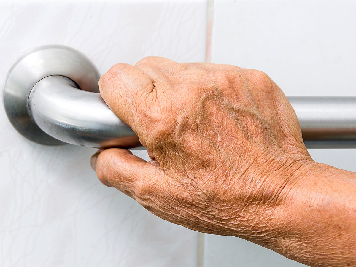 Caring for aging parents - grab bar beside toilet