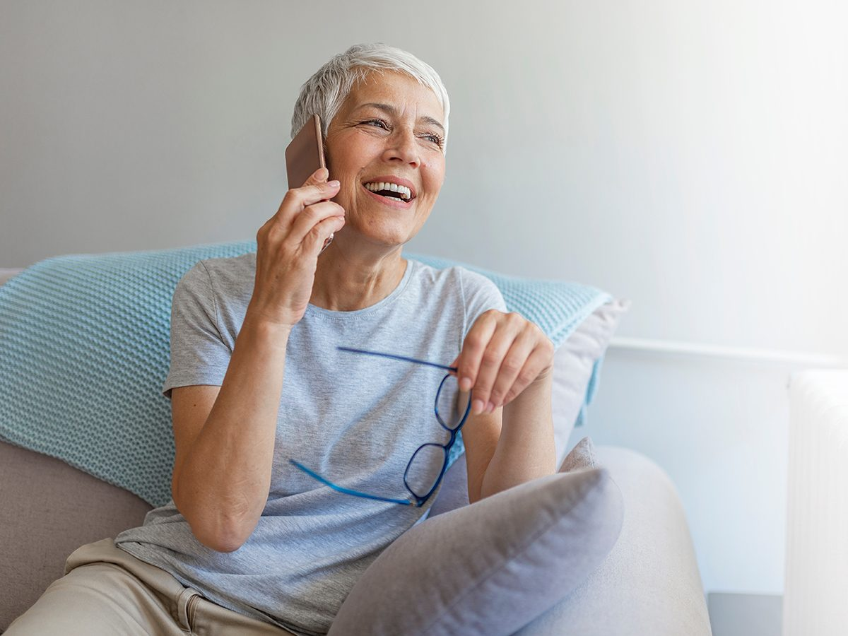 Caring for aging parents - senior woman on the phone