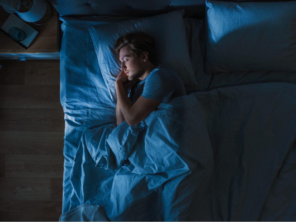 Man sleeping in bed at night
