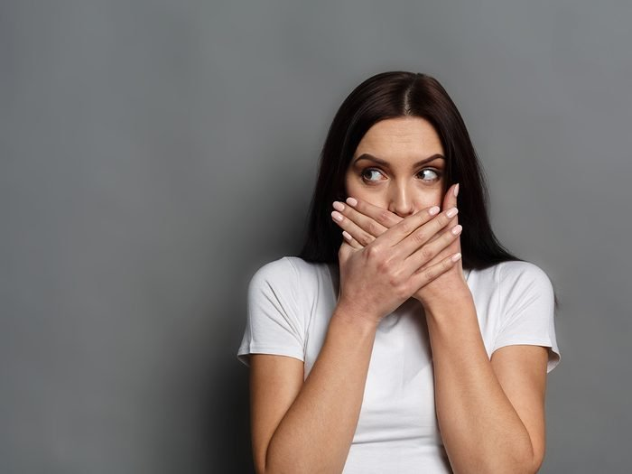 How to get rid of hiccups - embarrassed woman hiccuping