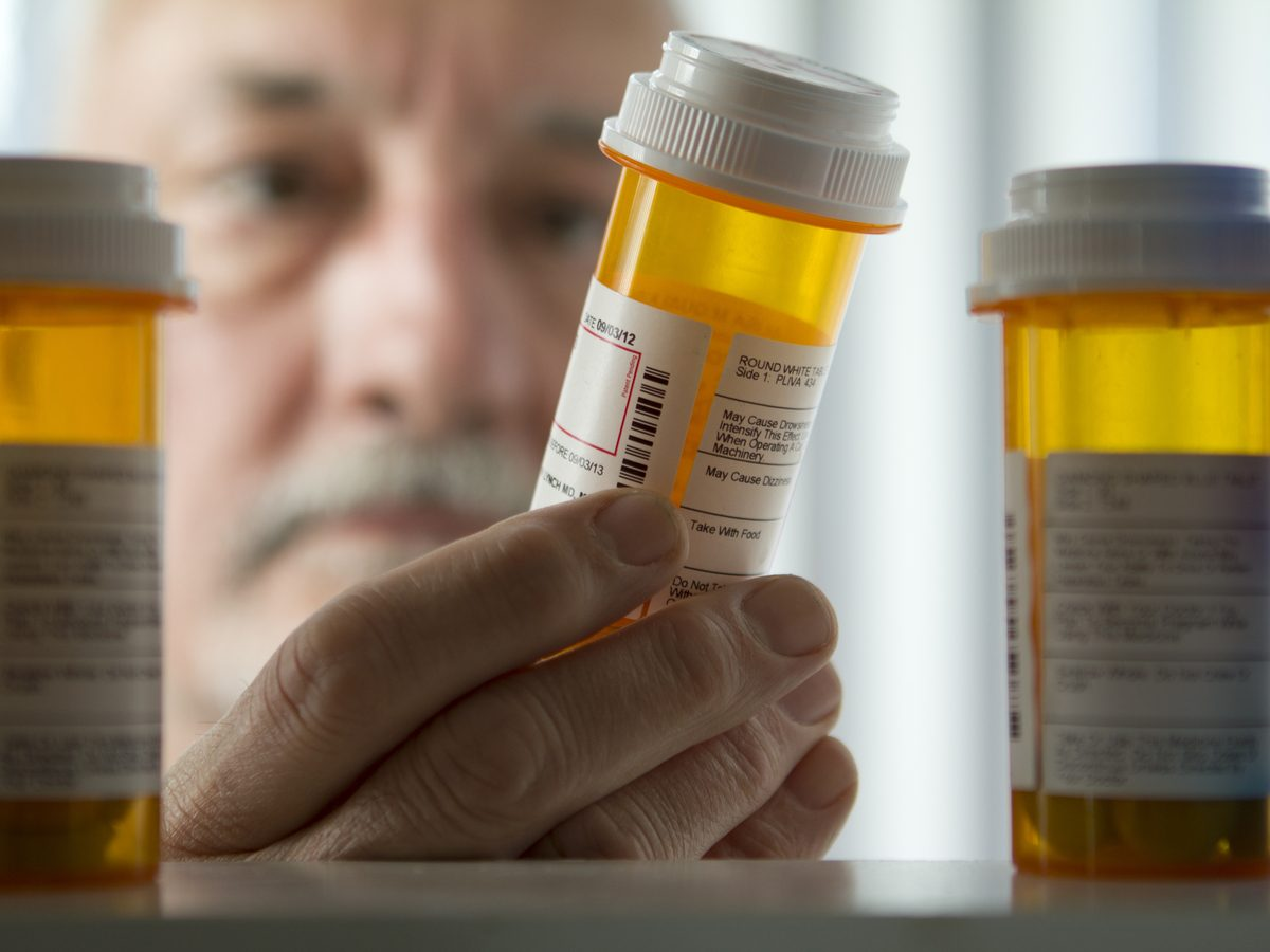 Middle-aged man looking at his medicine cabinet