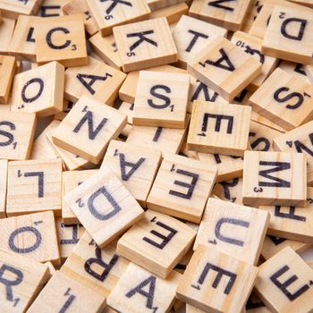Palindrome words - Wooden Scrabble letter tiles on white background from above