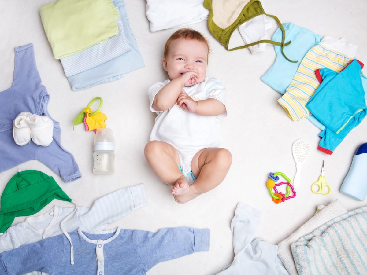 Cute baby posing with baby clothes