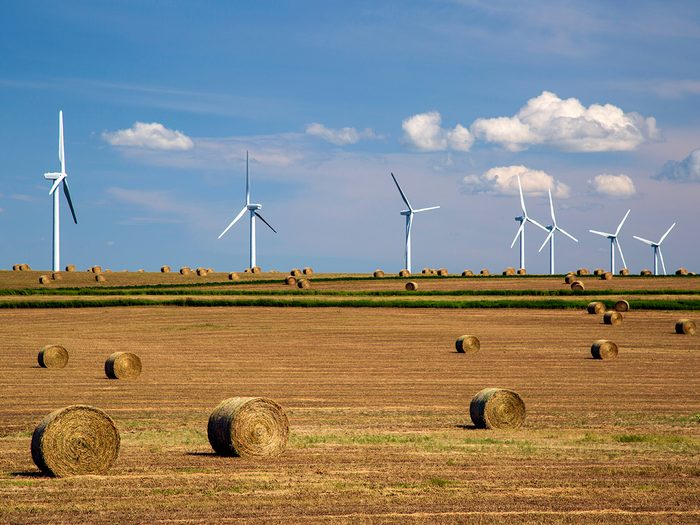 Summer Canada 2021 forecast - Wind turbines and hay bales on Prairies