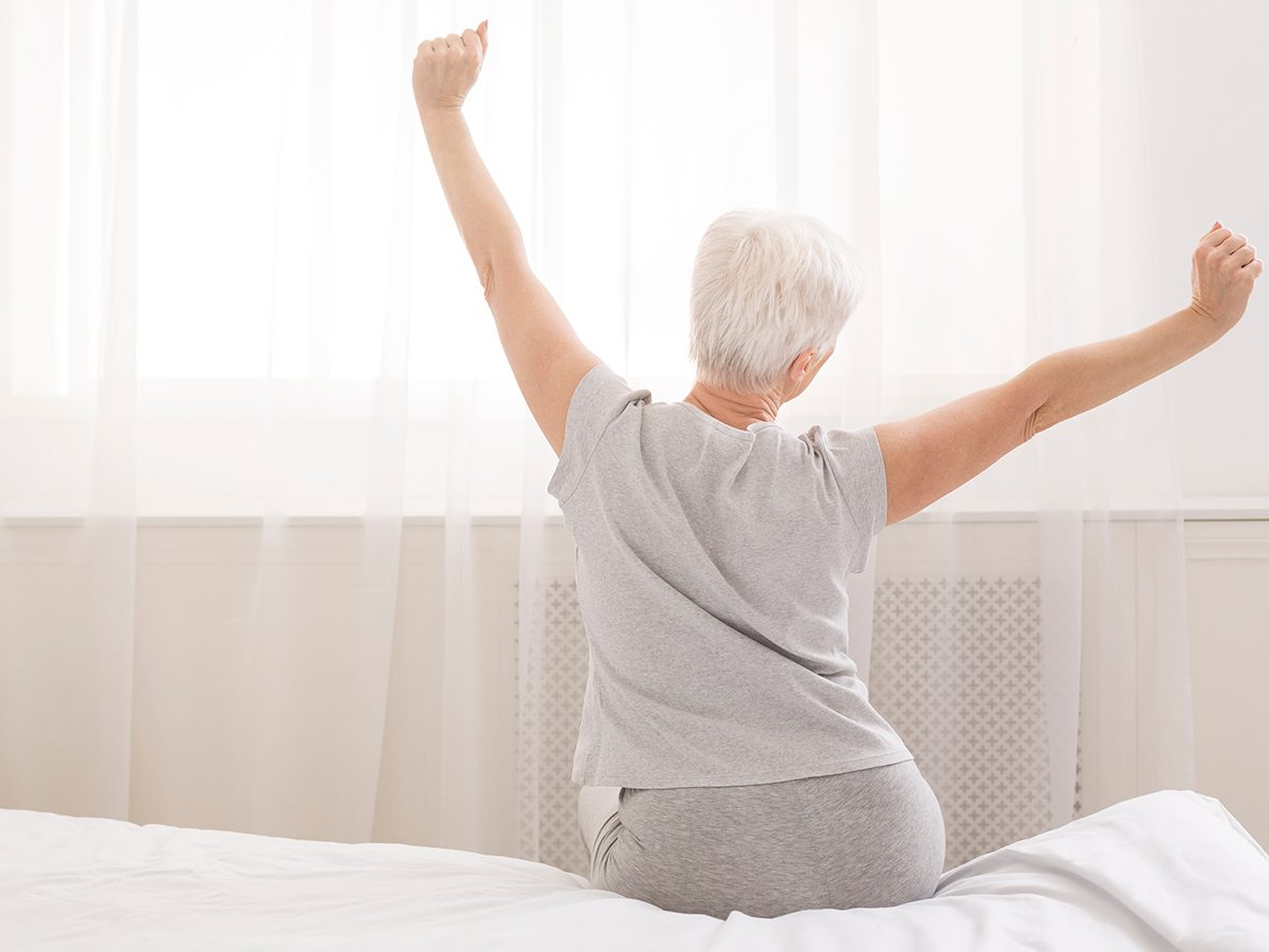 Things that slow down aging - senior woman waking up