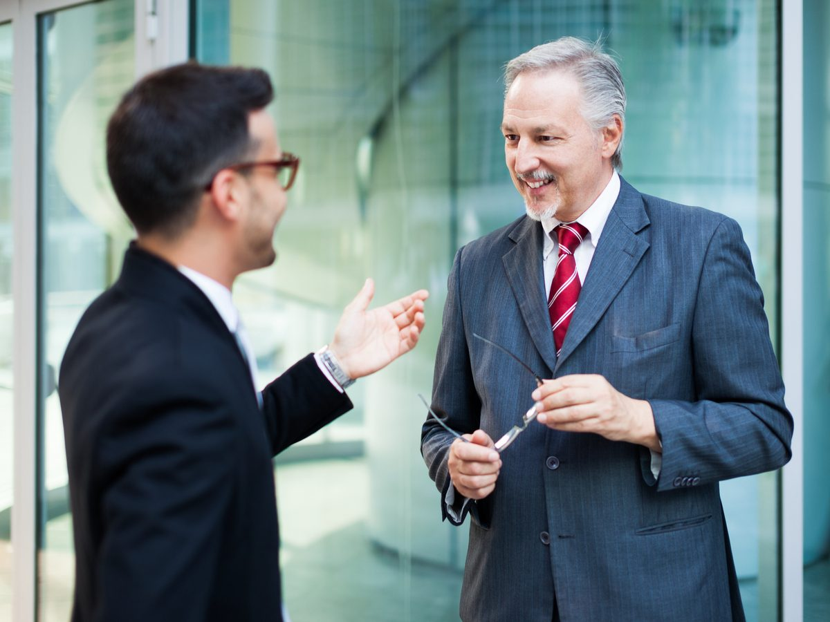 Senior boss talking to one of his employees