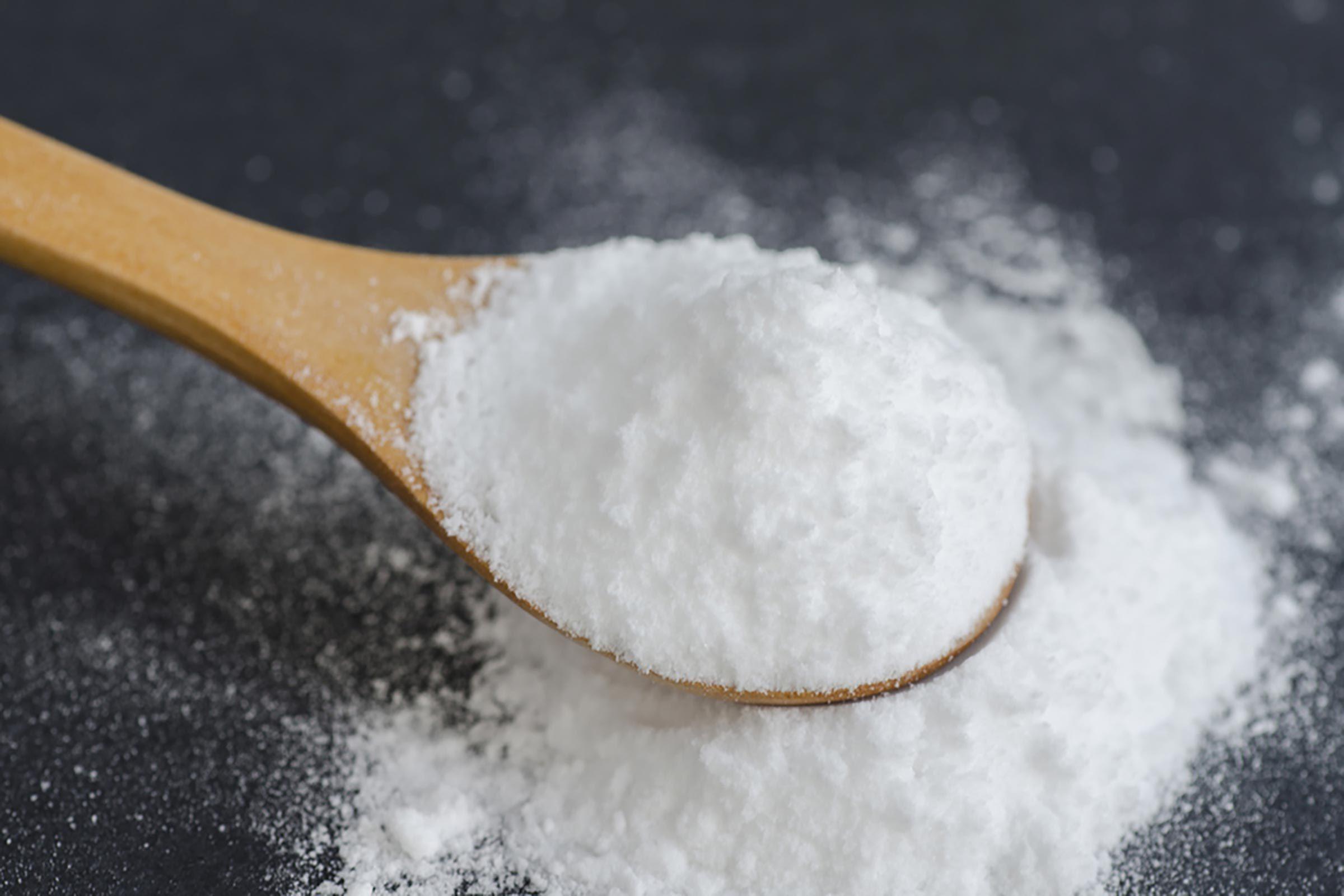baking soda in a spoon