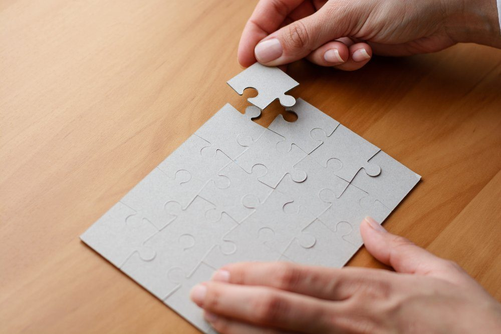 hands doing a puzzle
