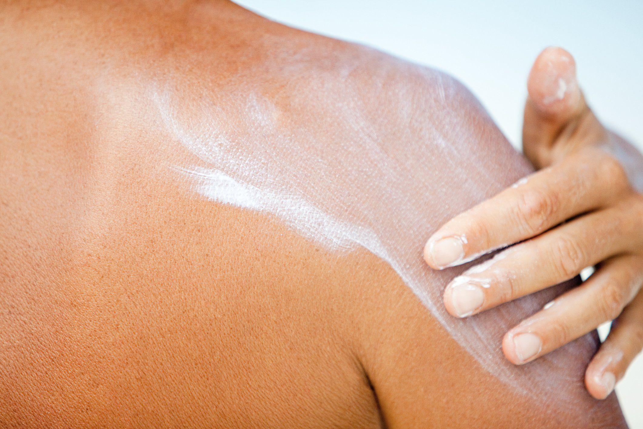 Woman applying sunscreen, Maldives