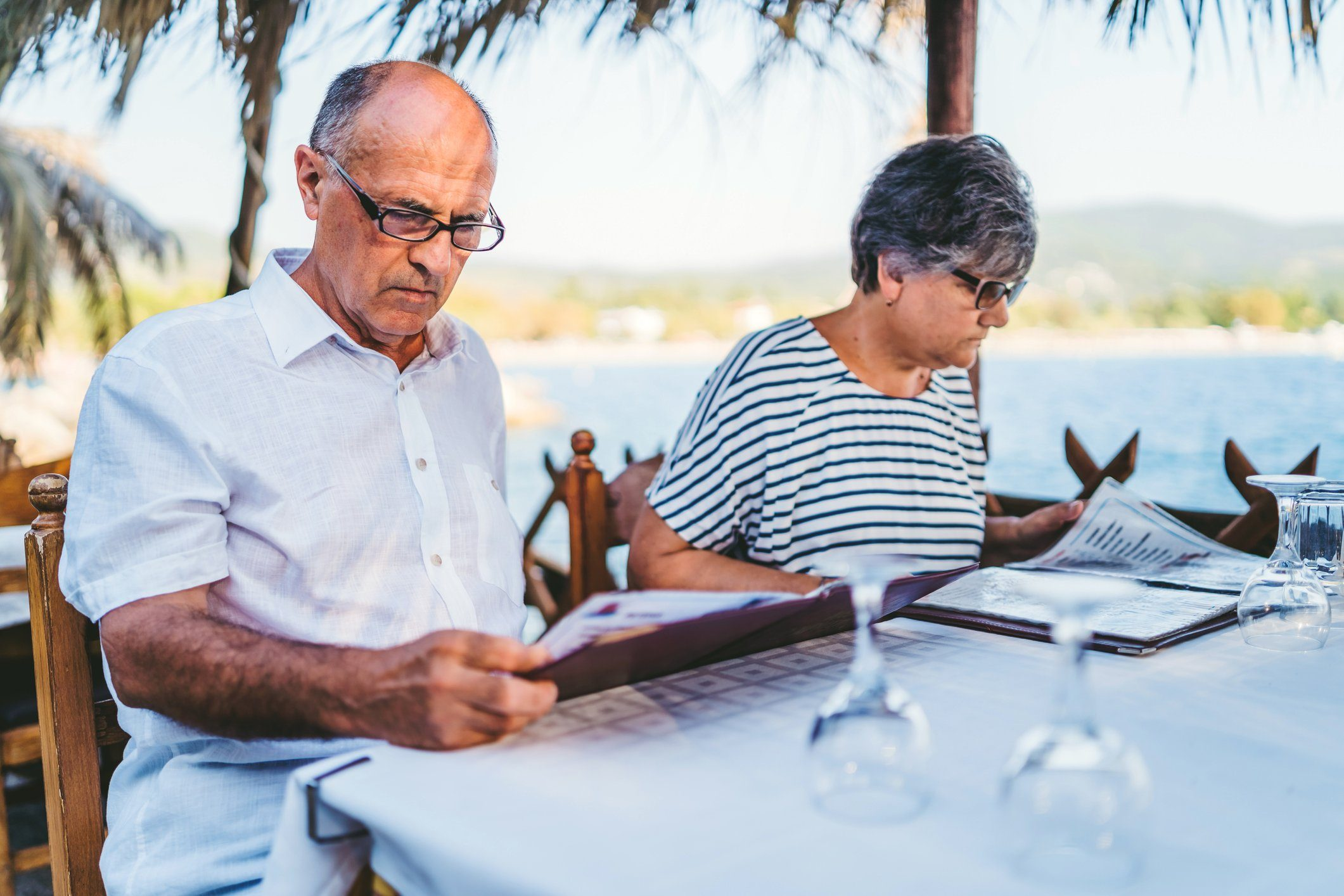 Senior couple looking at restaurant menu