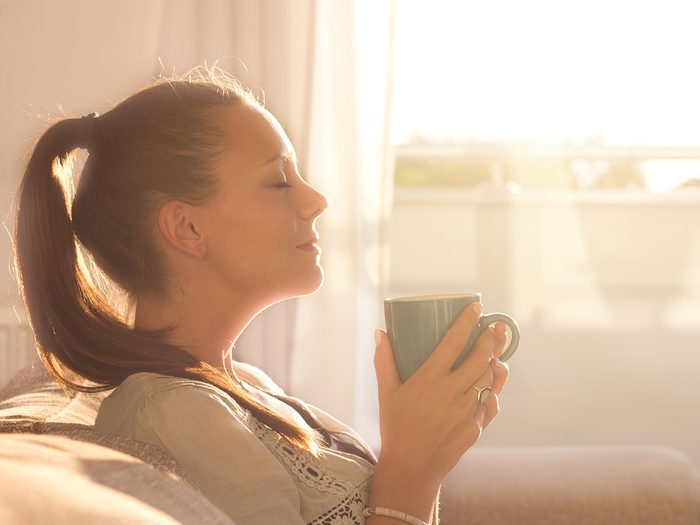 Caffeine withdrawal - woman enjoying morning coffee
