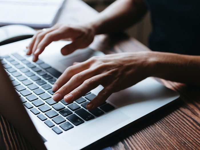 How I fell for an email scam - typing on laptop