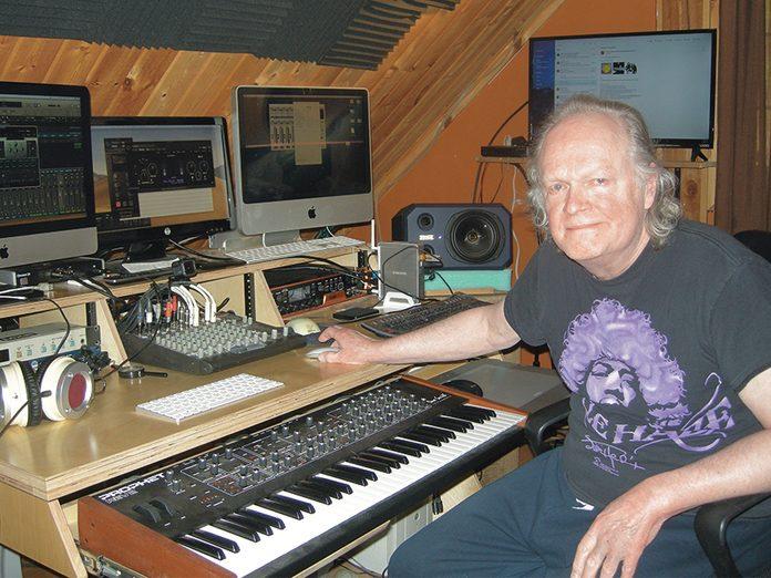 Klaatu guitarist Dee Long in his home studio