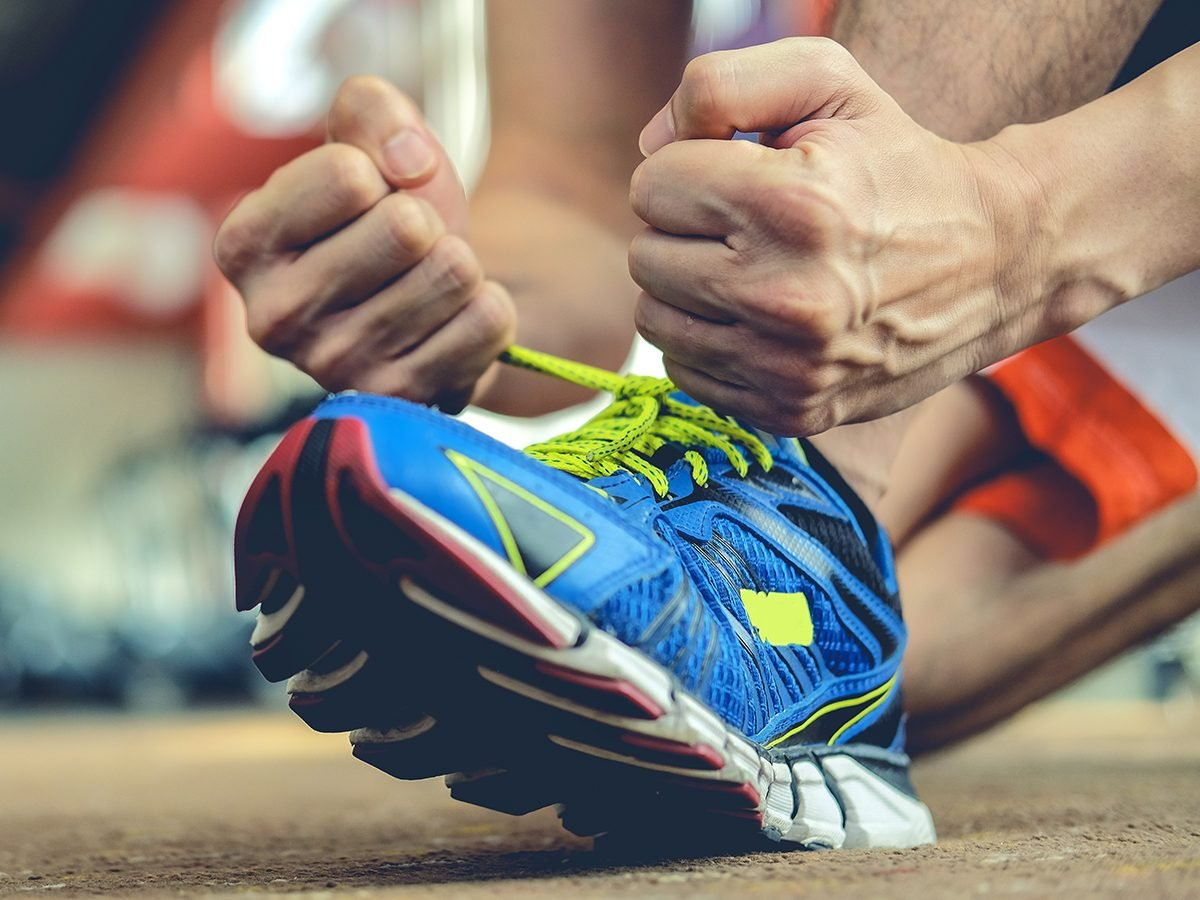 Outrageous news stories - man lacing running shoe