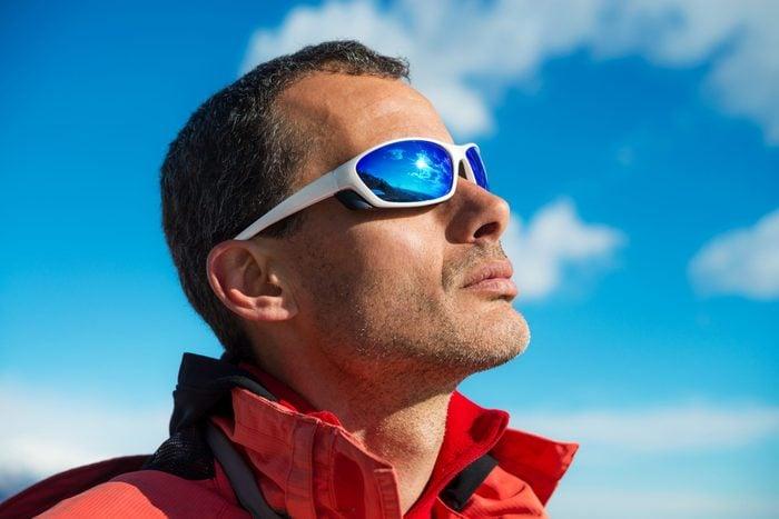 Sunglasses myths - Man wearing sports sunglasses outside