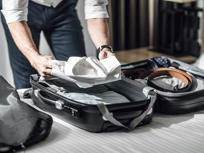 Uses for pillowcases - man packing suitcase