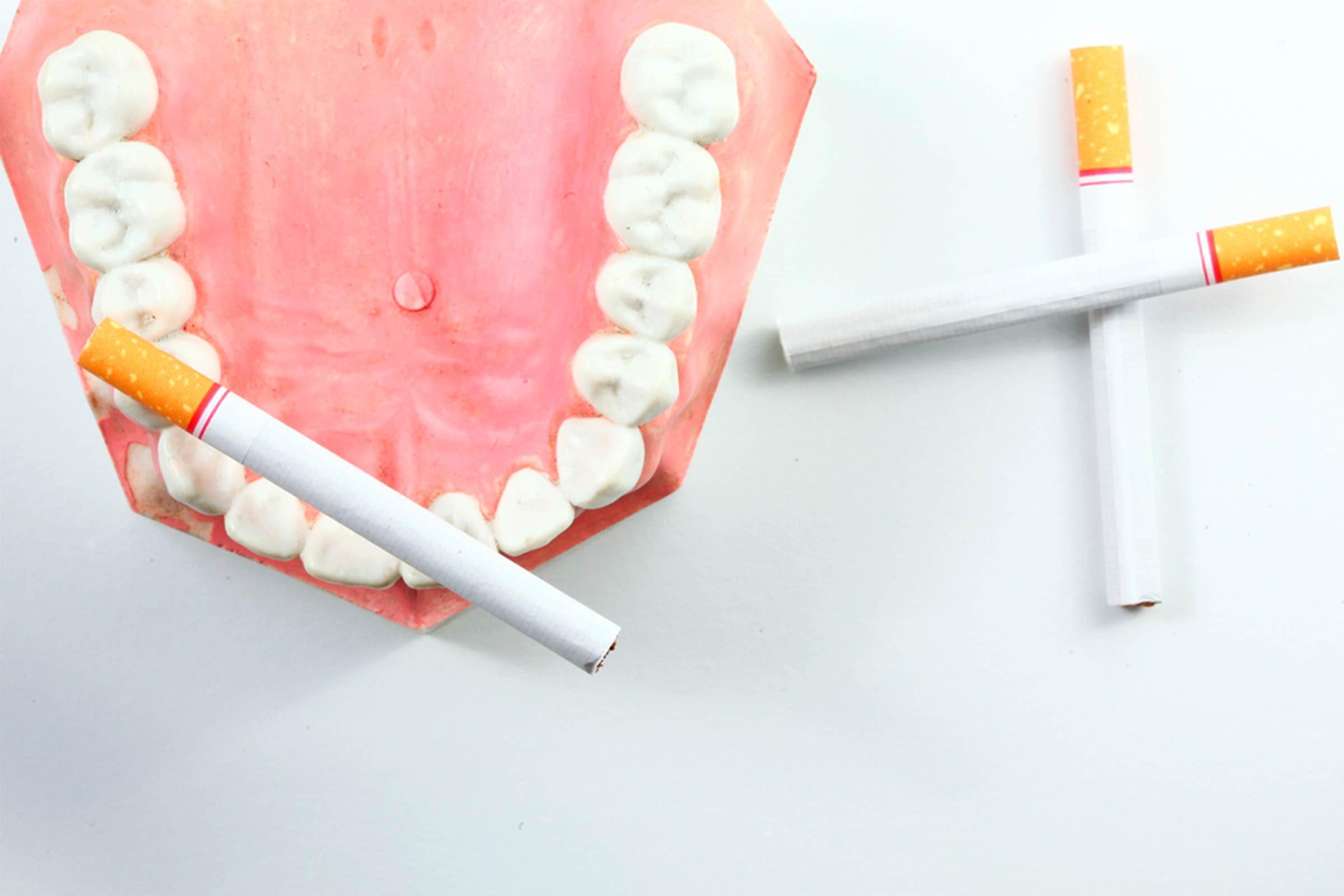 fake teeth and cigarettes