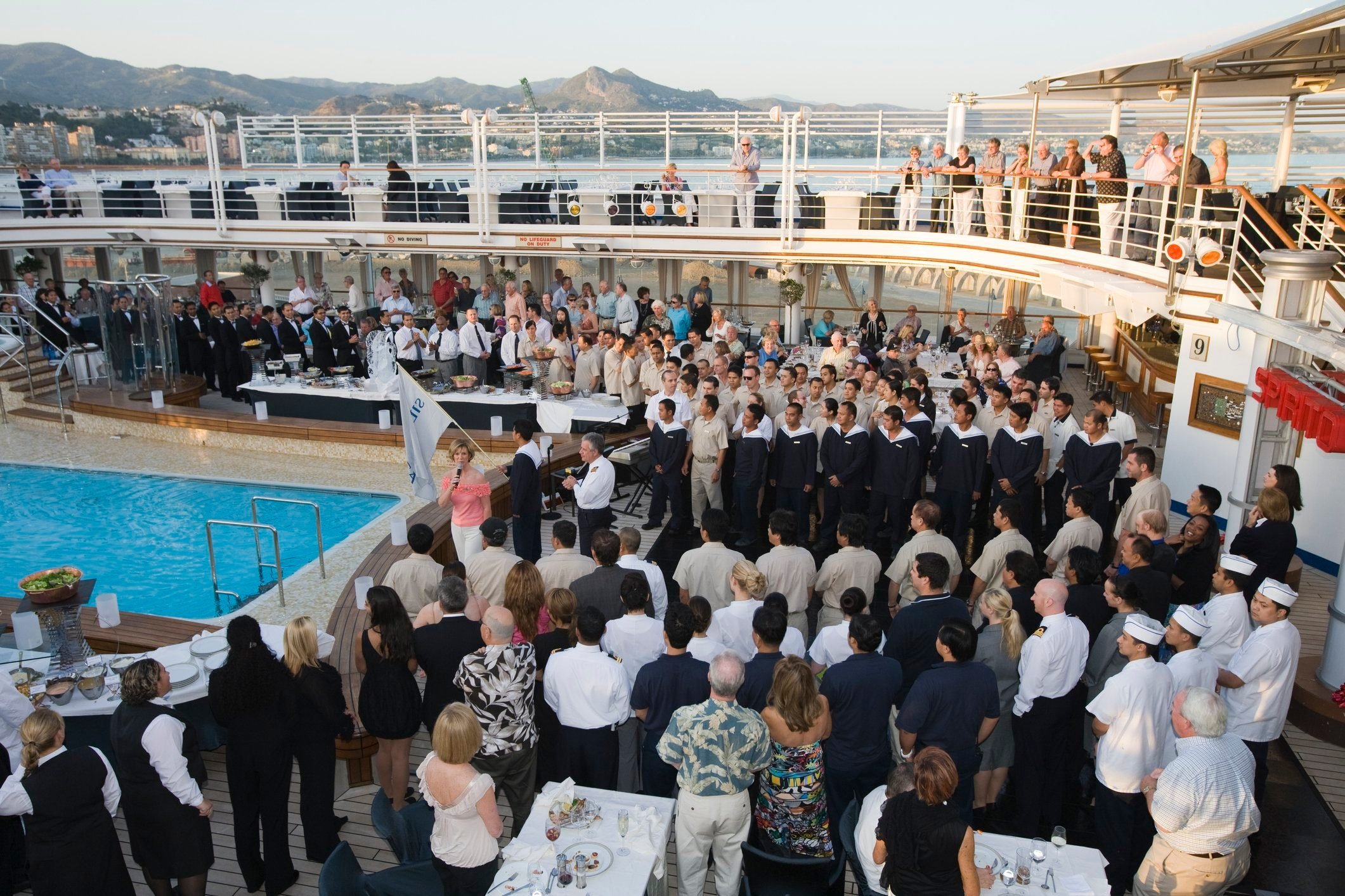 Crew being introduced during pool deck barbecue aboard cruiseship Silver Spirit (Silversea Cruises).