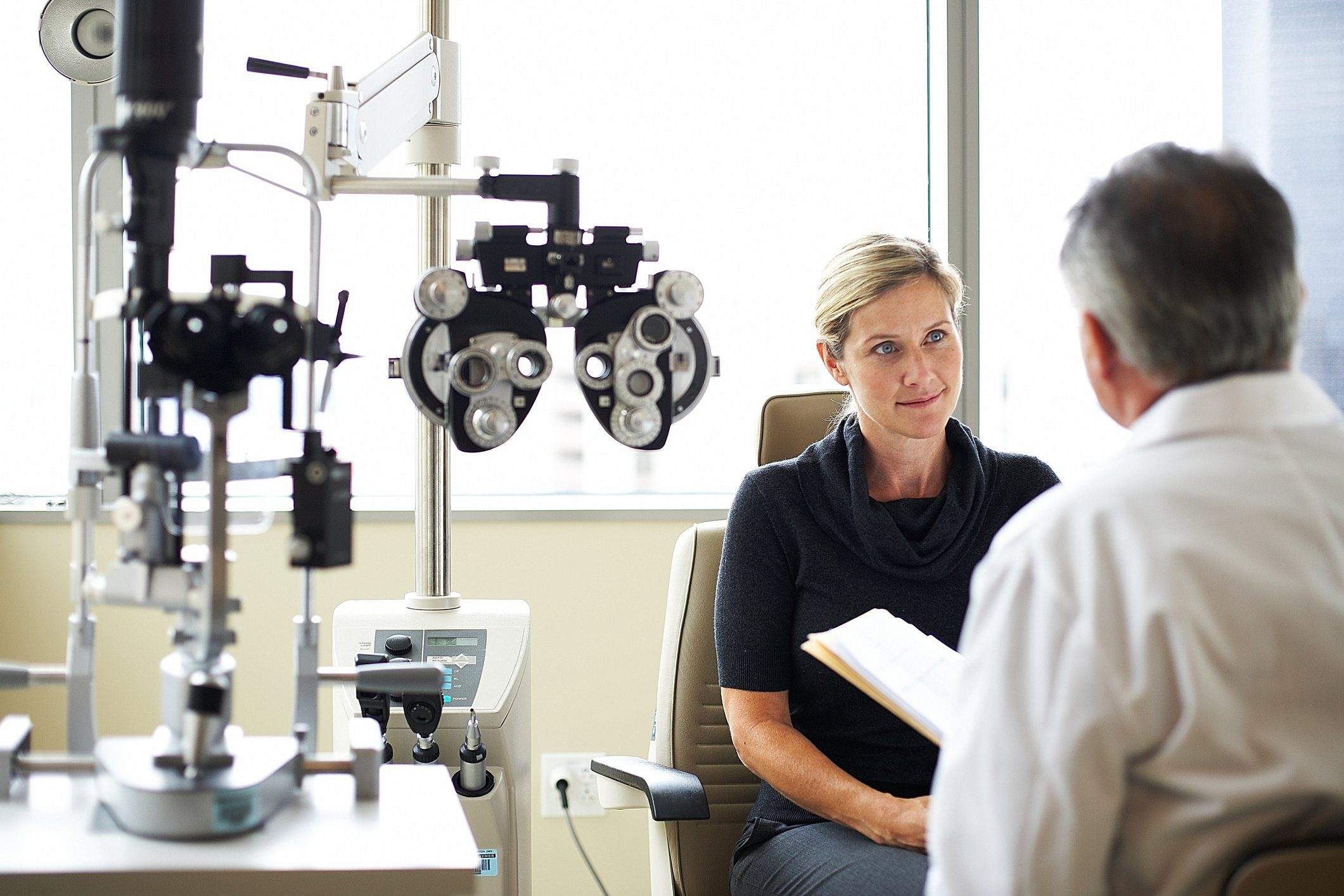 opthamologist and patient having a conversation after eye exam
