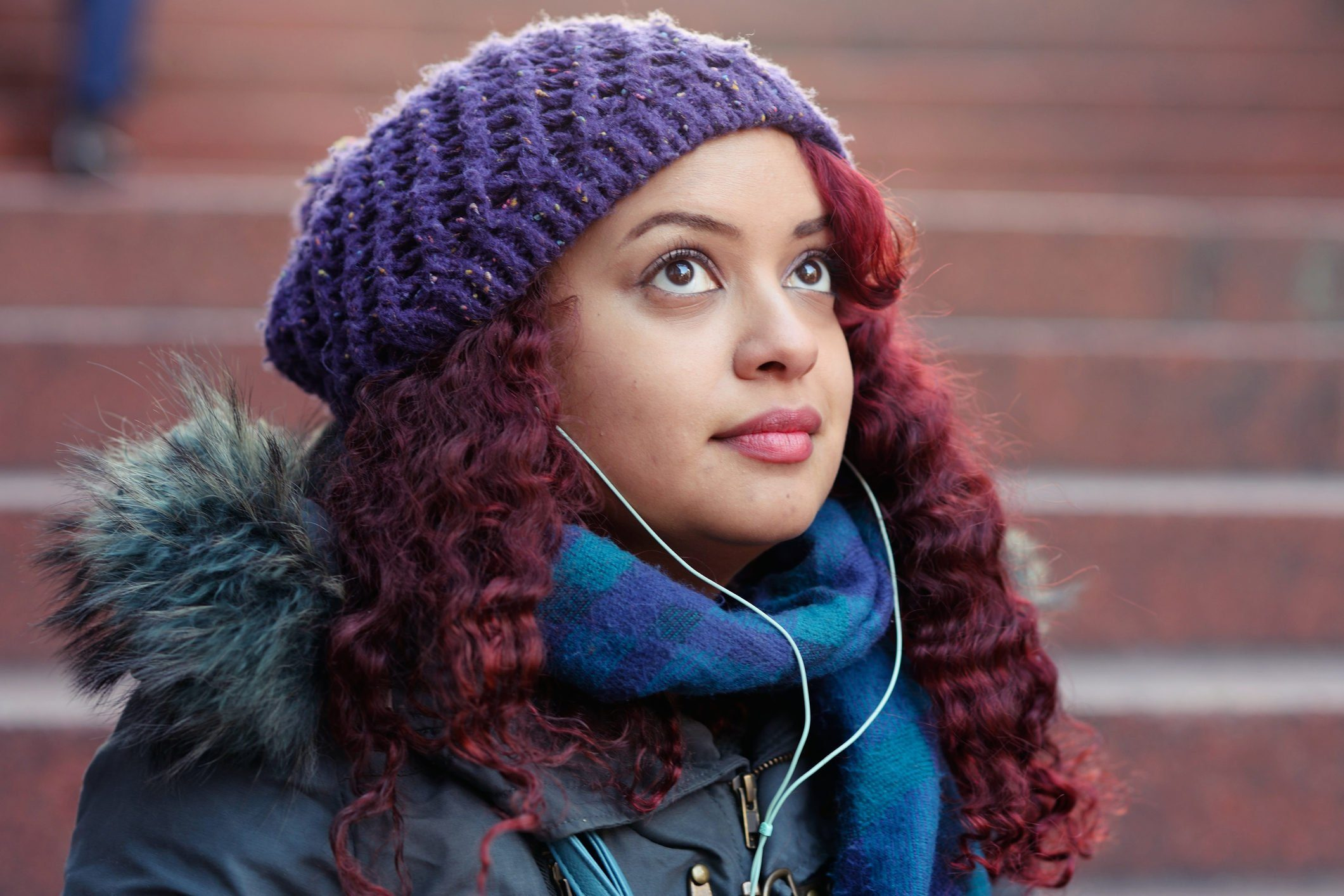 Young woman listening to music