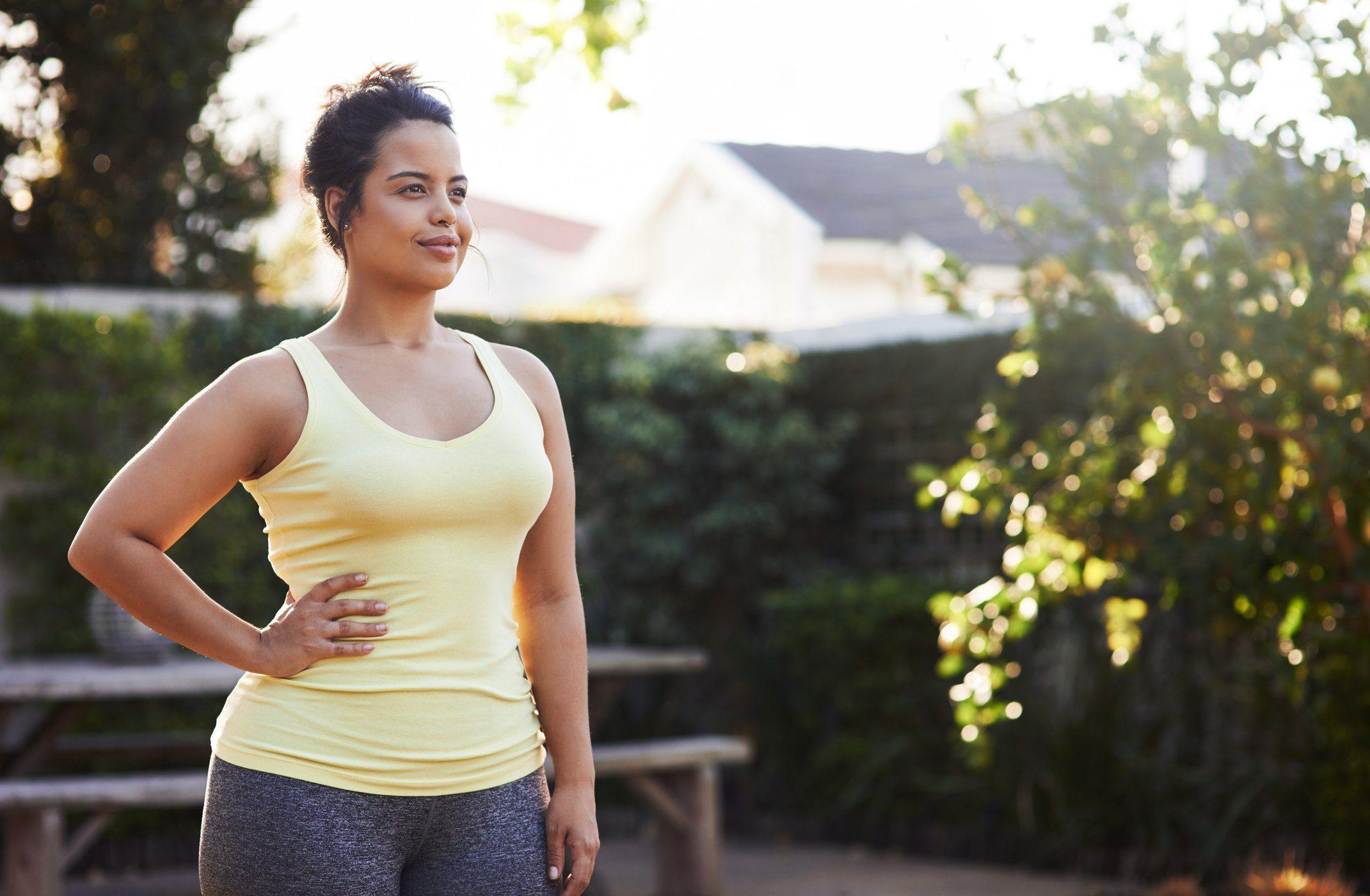 Woman strength-training outdoors