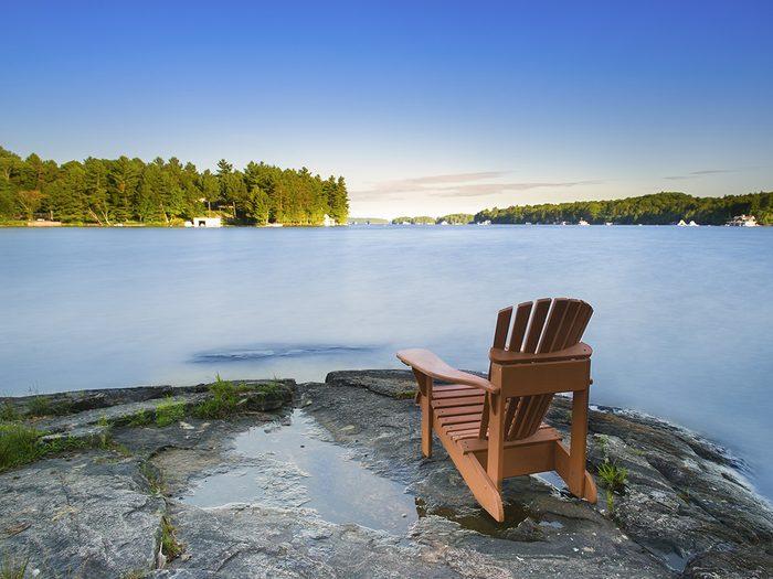 Canada geography facts - Muskoka chair on lake