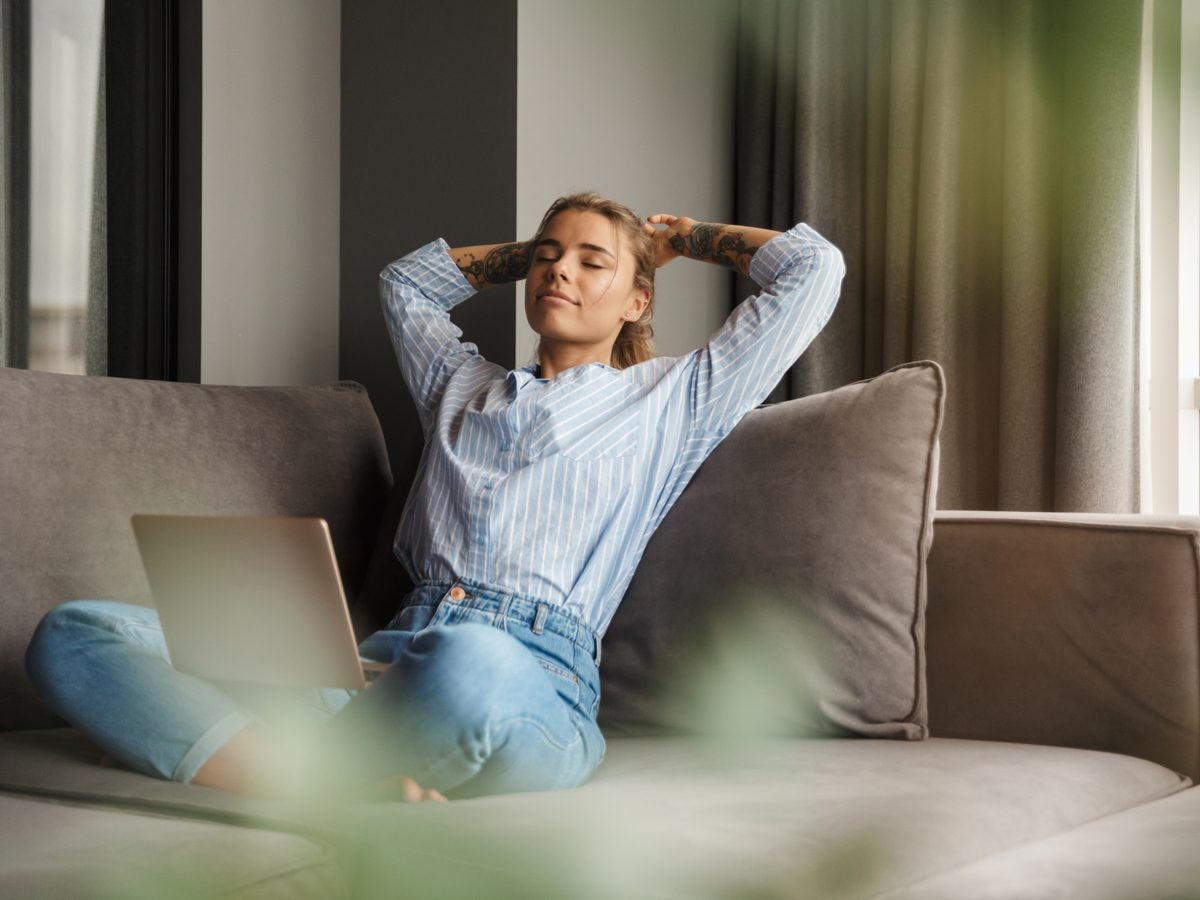 Woman relaxing on her couch at home