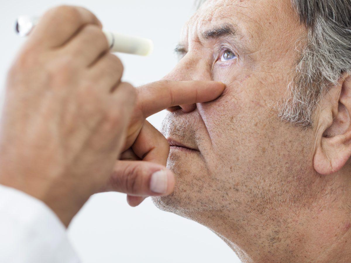 Senior man undergoing eye exam
