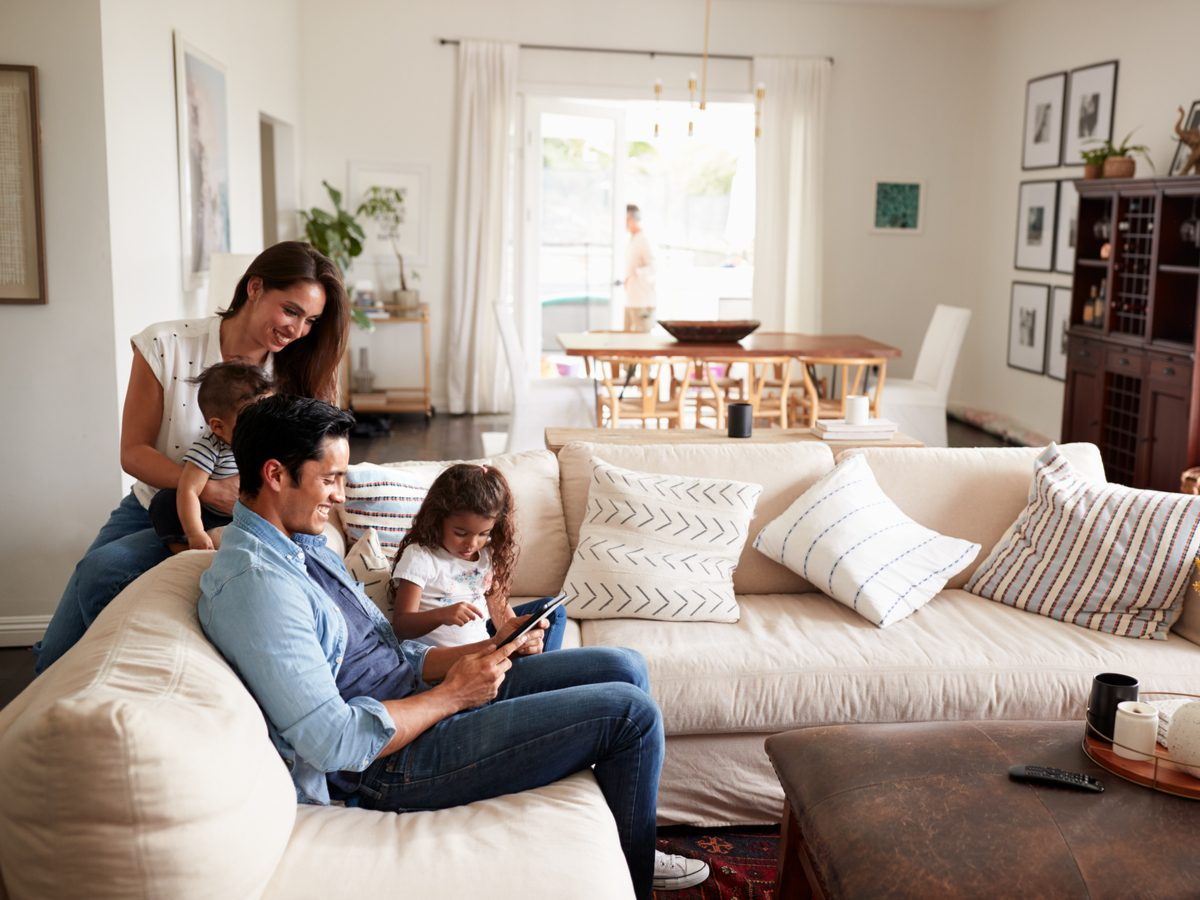 Family of four in their living room