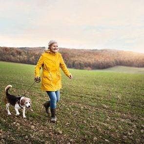How to make walking less boring - woman walking dog