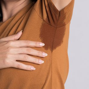 How To Sweat Less This Summer - Sweat Stains on Shirt
