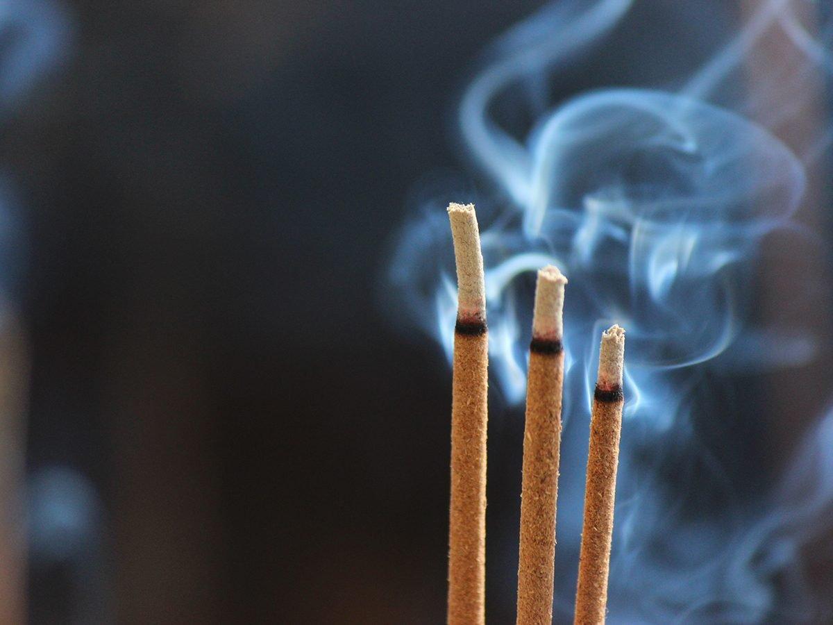 Incense sticks burning with smoke