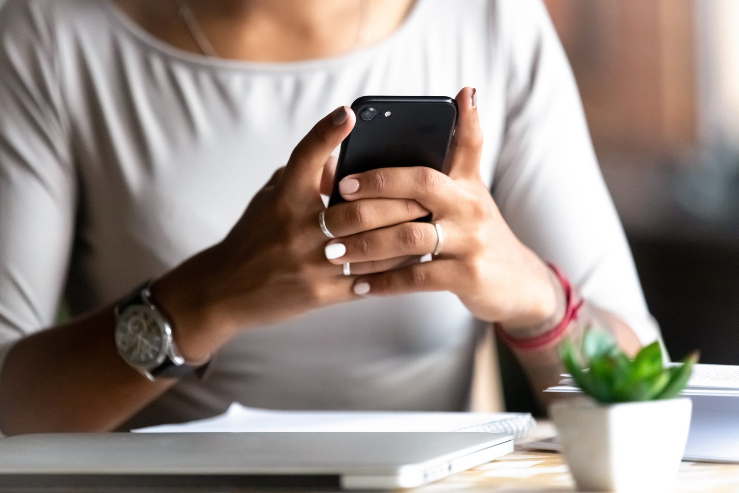 Close up woman holding smartphone, typing message, texting, chatting, female hands using cellphone, browsing mobile apps, internet, checking social networks, email, playing games on phone