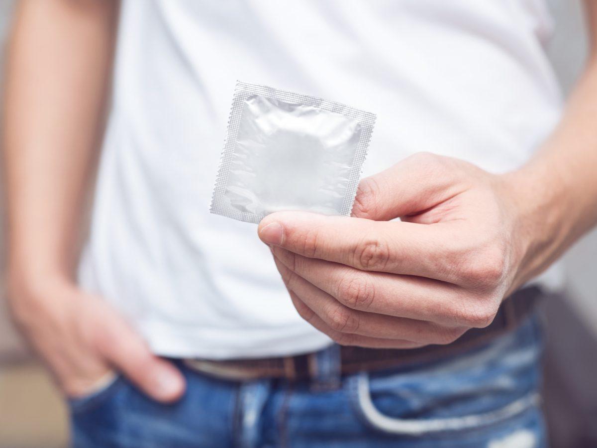 Man holding condom
