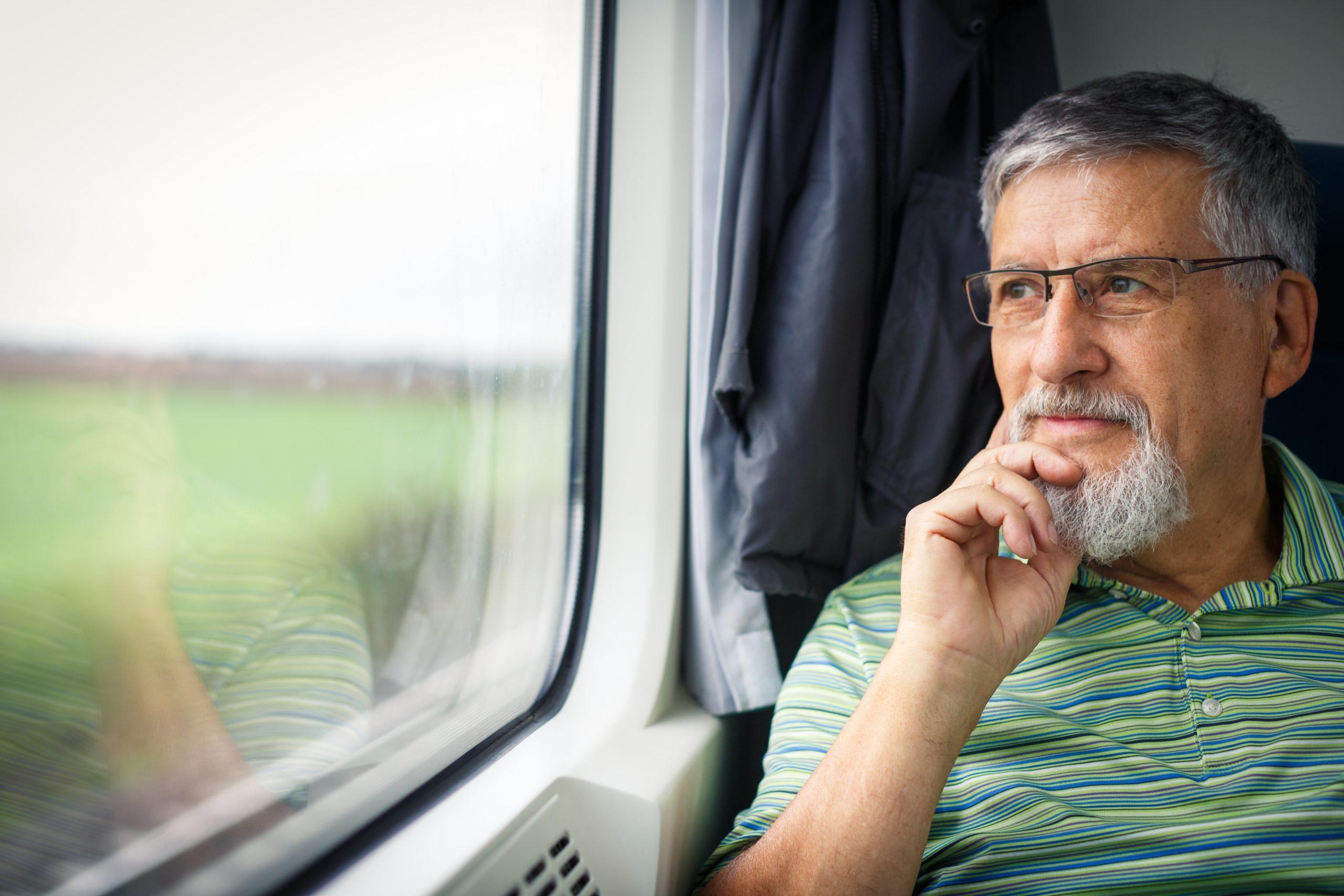 Man thinking on train