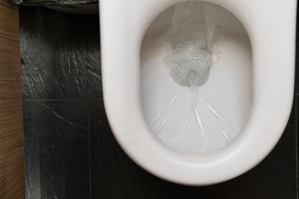 water in toilet bowl flushing