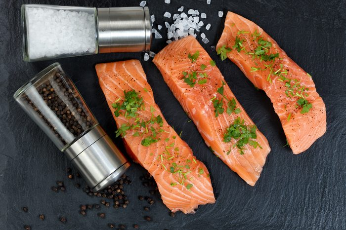 Preparing raw wild salmon steaks for meal time