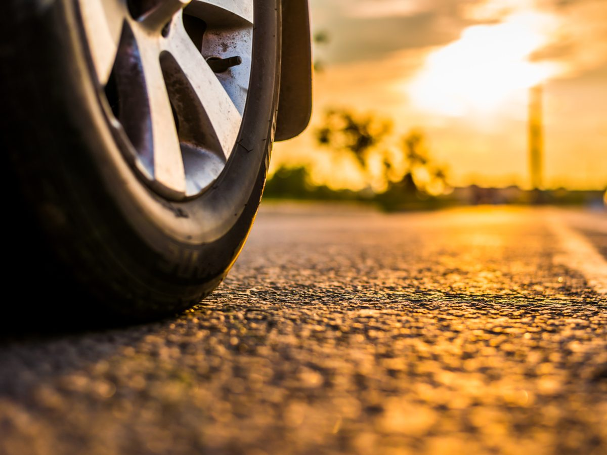 Close-up of car tire on an open rural road