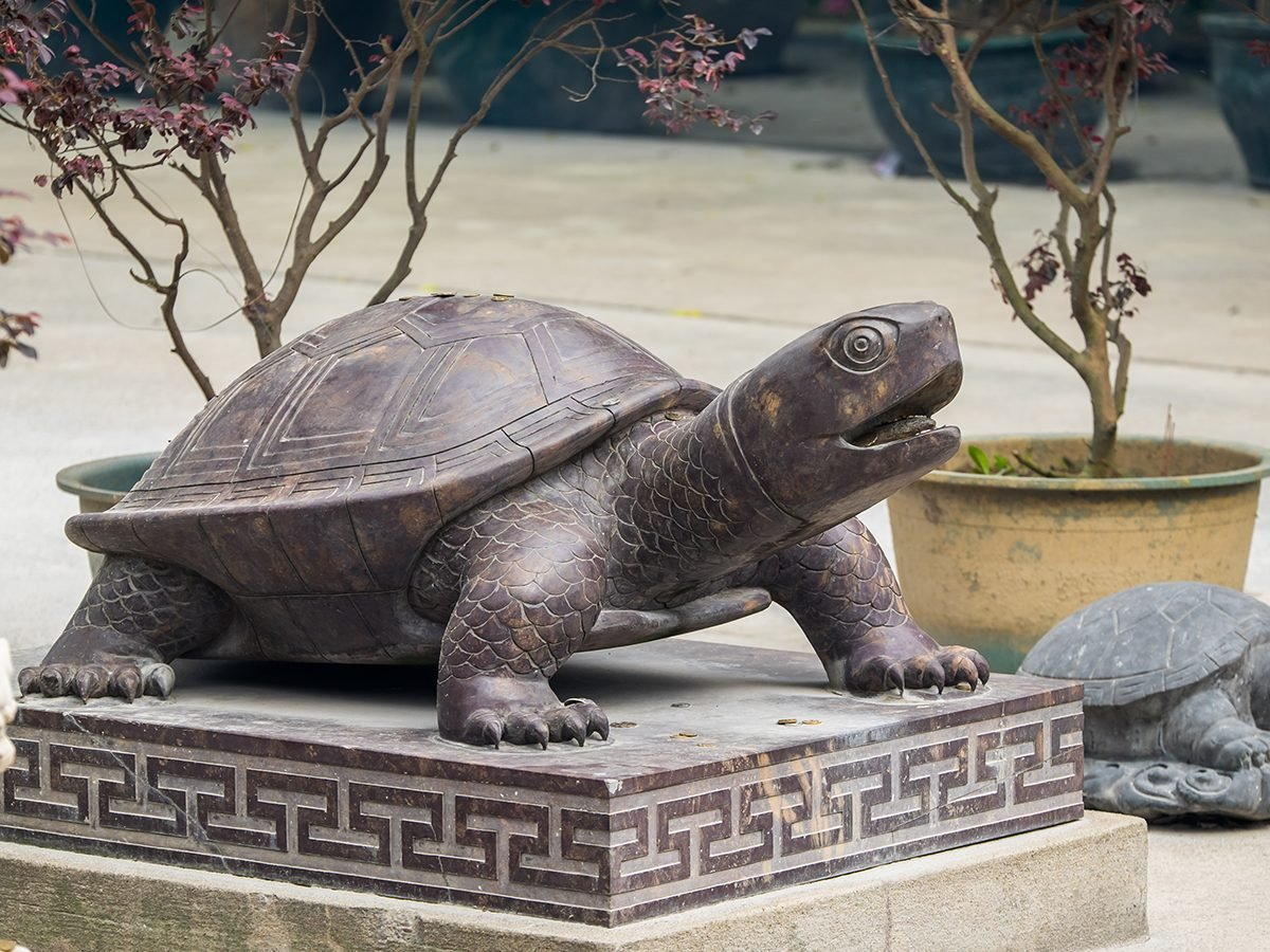 Lucky bronze turtle for longevity, defends the home in Feng Shui. Lantau Island, Hong Kong. 13th May 2016