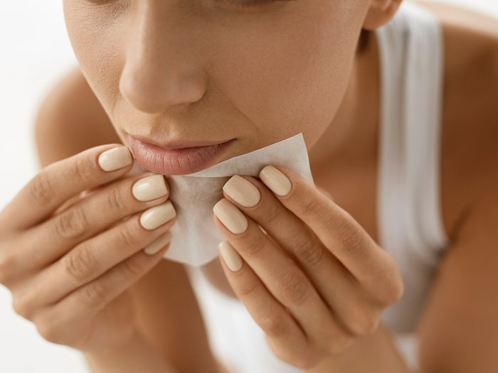 Uses for coffee filters - Skin Care. Woman Removing Oil From Face Using Blotting Papers. Closeup Portrait Of Beautiful Healthy Girl With Nude Makeup Cleaning Perfect Soft Skin With Oil Absorbing Tissue Sheets. Beauty Concept
