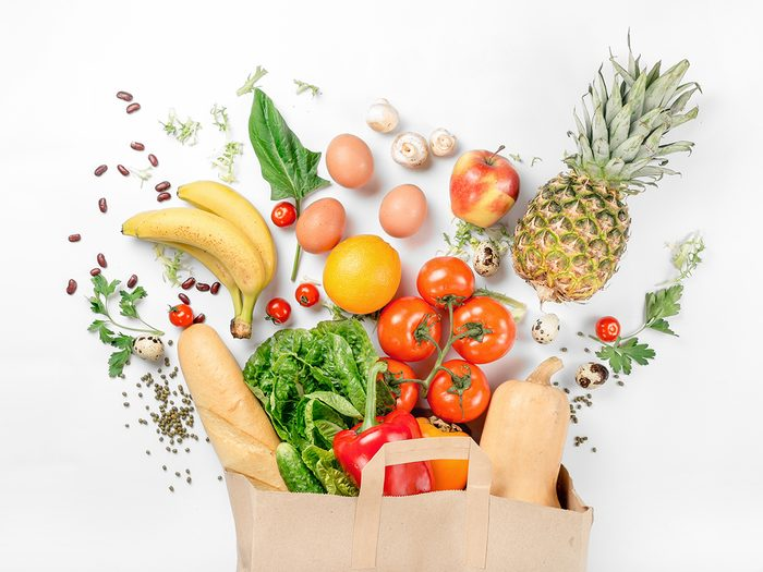 Fresh produce in a brown paper grocery bag
