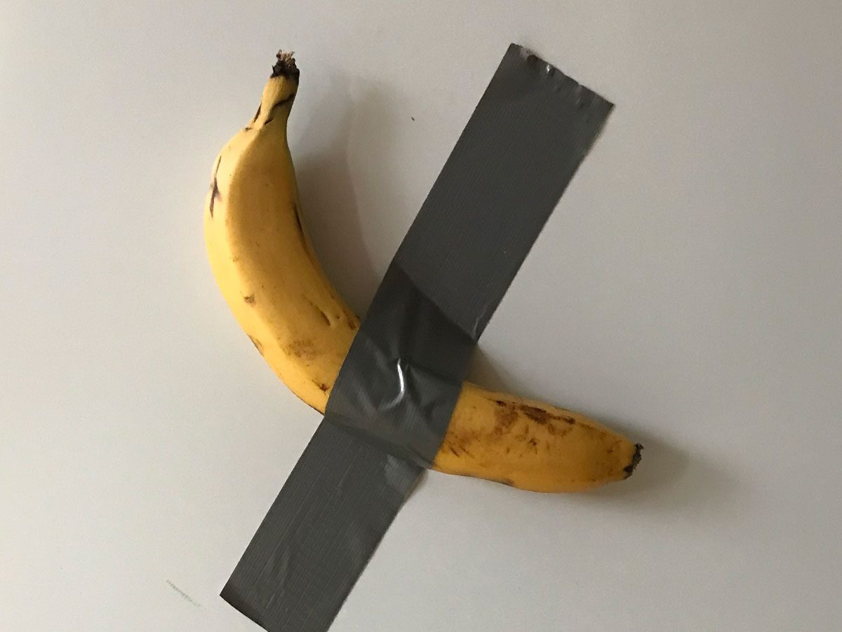 Banana duct taped to a white wall