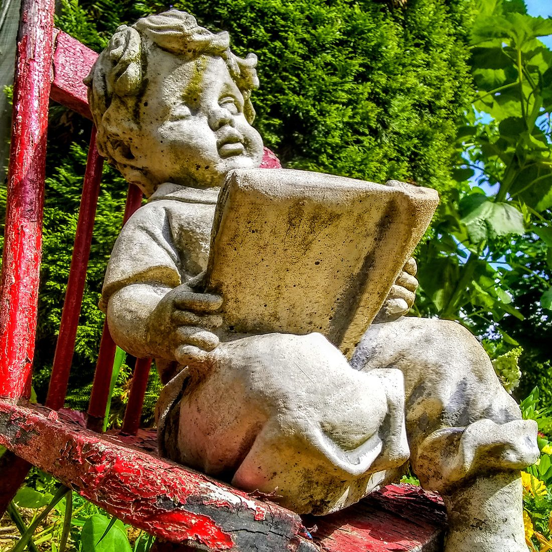 In the backyard photography - little reading boy statue