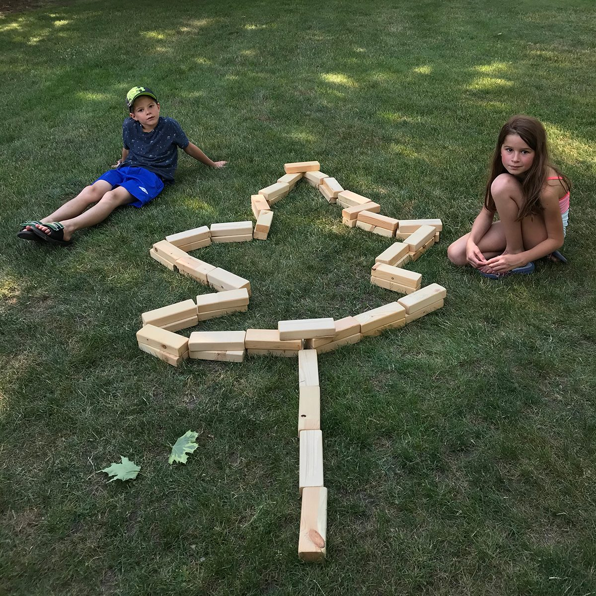 In the backyard photography - kids with maple leaf building blocks
